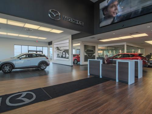 Wilkins Mazda interior showroom welcome desk right side