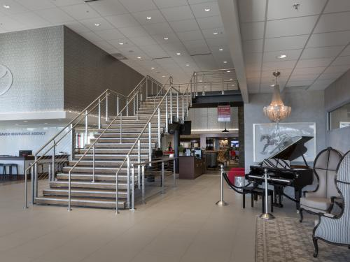 Beaver Toyota Interior grand stairs with piano